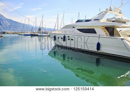 boats reflected on sea at Kalamata harbor Peloponnese Greece
