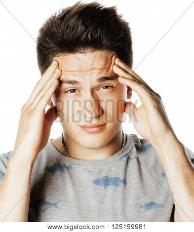 young pretty real man with head ache holding hands isolated close up thinking