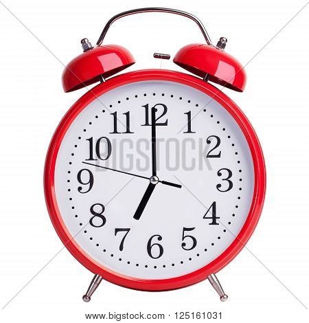 Red alarm clock shows exactly seven o'clock