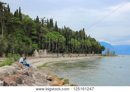 Sirmione, Italy, 01 October 2015: Promenade near the Scaliger Castle in the Sirmione city, Italy