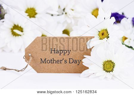 Mothers Day card and daisies. Extreme shallow depth of field with selective focus on card.