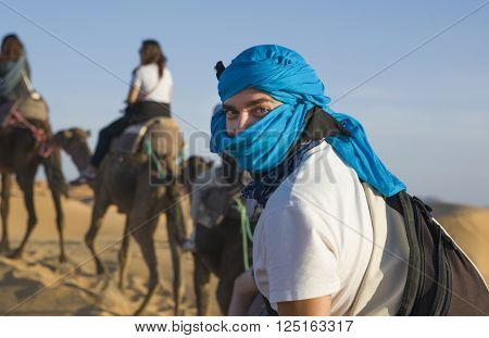 Tourists on the desert trip near Merzouga in Erg Chebbi in Morocco