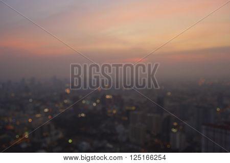 Blurred aerial view of cityscape on warm light sundown Bangkok Thailand