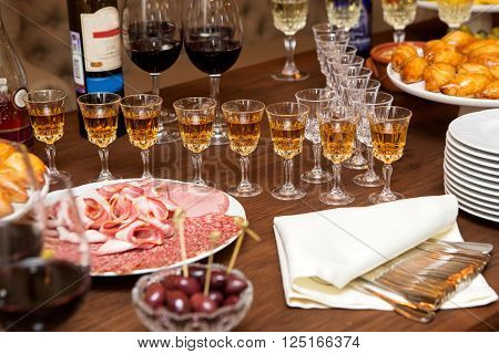 Table for aperitif glasses with brandy and wine