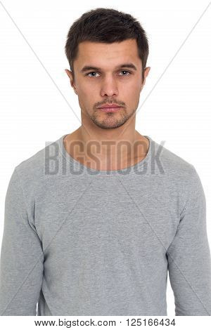 Portrait of a serious young man isolated on white