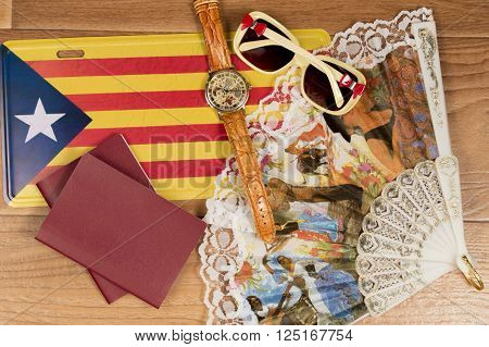 The trip to Catalonia. Copy space. Passports fan flag watch