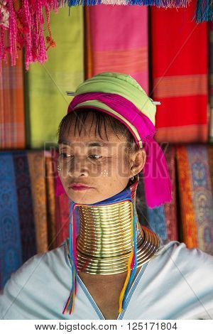 CHIANG MAI, THAILAND - FEBRUARY 01, 2016: Unidentified woman from Karen Long Neck Village near Chiang Mai Thailand. This village is a part of very popular Hill tribe tourism in Thailand.