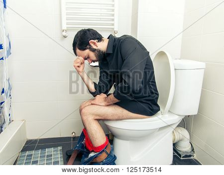 man having problems in the home toilet