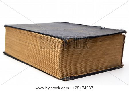 Old big closed book on white background