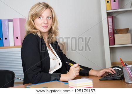 Portrait Of Beautiful Woman In Office Seems Confident