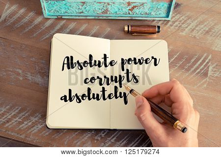 Handwritten quote Absolute power corrupts absolutely, as inspirational concept image