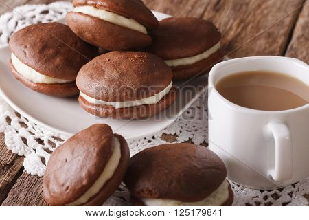 Chocolate Whoopie pie and coffee with milk close-up. horizontal
