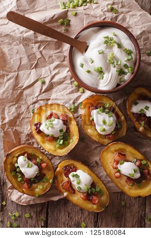 Potato Skins With Cheese, Bacon And Sour Cream Close-up. Vertical Top View
