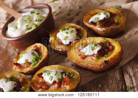 Baked Potato Skins With Cheese, Bacon And Sour Cream Close-up. Horizontal