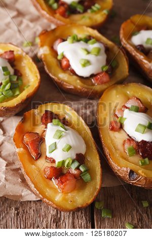 Stuffed Potato Skins With Cheese And Bacon Close-up On The Table. Vertical
