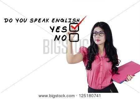 Beautiful young english teacher holding document and writes Do You Speak English