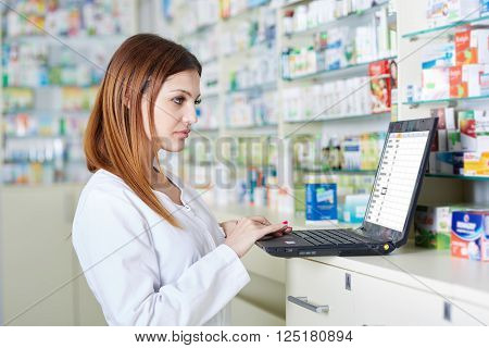 Pharmacist Checking Drugstore Stock