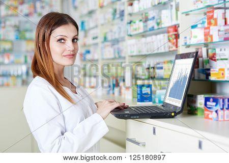 Pharmacist Checking Drugstore Stock