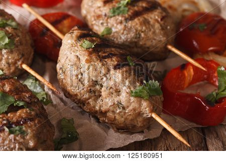 Homemade Kofta Kebab With Grilled Vegetables On A Table Macro. Horizontal