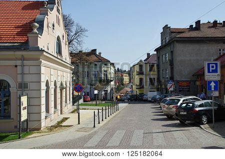 Wieliczka, Poland - April 04, 2016: Tadeusz Ko?ciuszko Square. Townhouses, some people are walking. On the left