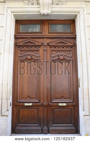 Classical and old door in the city of Paris