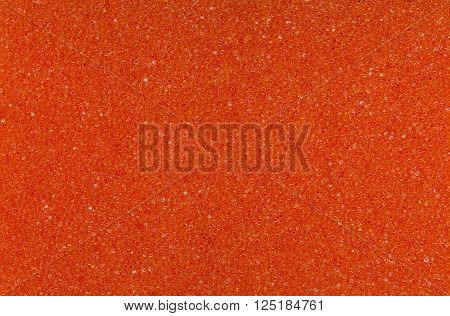 An orange color spongy macro texture background