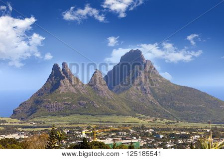 The city at the bottom of mountains. Mauritius in a sunny day