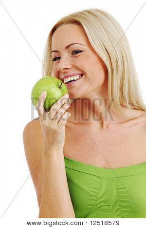 blond woman eat green apple