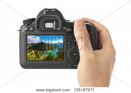 Hand with camera and Piva Canyon - Montenegro image (my photo) isolated on white background