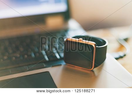 Smart Wrist Watch On The Notebook