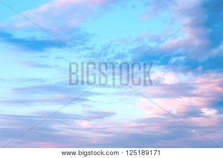 Blue sky and white light clouds closeup.