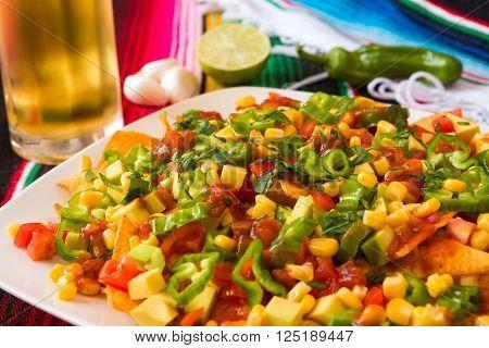 Close up of nachos salad over a colored poncho