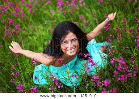 woman on pink flower field