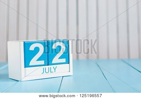 July 22nd. Image of july 22 wooden color calendar on white background. Summer day. Empty space for text.