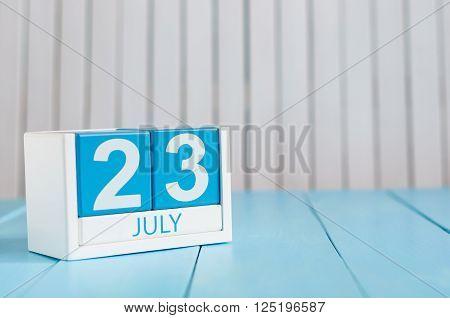 July 23rd. Image of july 23 wooden color calendar on white background. Summer day. Empty space for text. National Hot Dog Day. World Whale and Dolphin DAY.
