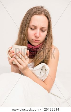 Close Up Photo Of Sick Girl Holding A Cup Of Hot Tea