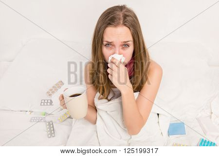 Sick Woman With Rheum Holding A Cup Of Hot Tea
