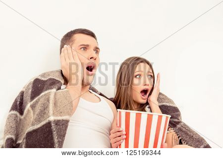 Afraid Man And Woman Watching Horror Film With Popcorn