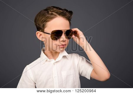 Young Funny Little Boy In White Shirt Wearing Spectacles