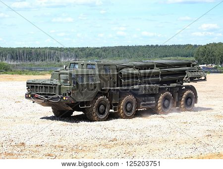 MOSCOW REGION  - JUNE 18: Multi launch rocket system with barrels on the vehicle chassis on a march over rough terrain  -  on June 18, 2015 in Moscow region