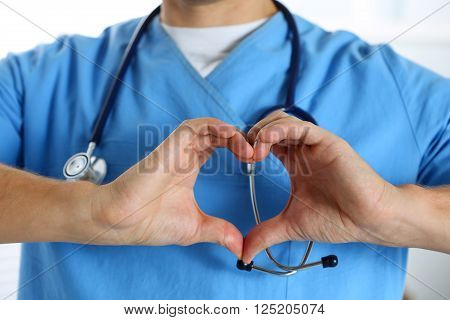 Hands Of Male Medicine Therapeutist Doctor Wearing Blue