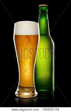 Green wet Bottle of beer and glass of beer on black background.