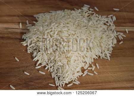 Healthy white rice on a wooden breadboard