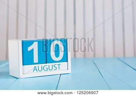 August 10th. Image of august 10 wooden color calendar on blue background. Summer day. Empty space for text.