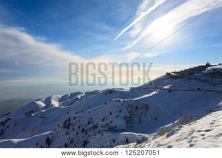 Winter panorama from Italian Alps. First world war memorial building. Snow