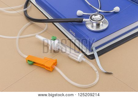 Blue agenda and stethoscope, administration of serum system