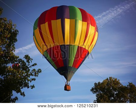 hot air balloons in the sky during sunrise on a summer day