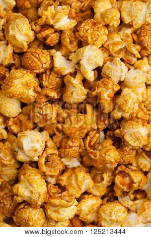 caramel pop corn background, closeup view
