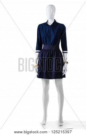Dark navy shirt on mannequin. Woman's plain navy shirt. Cotton skirt with dark shirt. Outlet store's new arrivals.