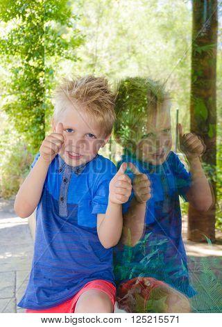Beautiful little boy smiling next to a window